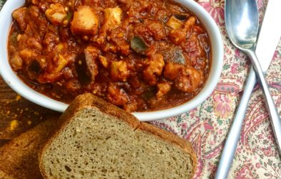 Harissa Chicken & Eggplant Stew served with a slab of homemade Bread